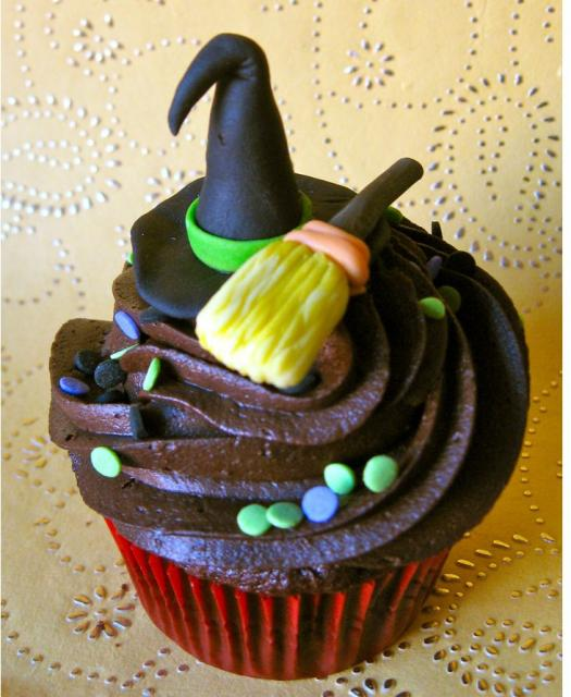 Chocolate cupcake with witch hat and broom.JPG