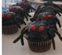 Dark chocolate halloween cupcakes with red eyes.JPG