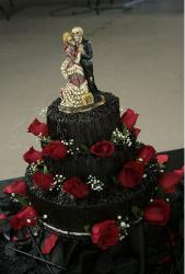 Dark chocolate wedding halloween cake with full of red roses.JPG