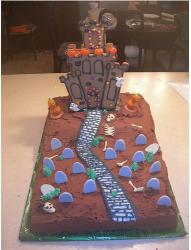 Gingerbread halloween cake with haunted house with cemetery in the front yard.JPG