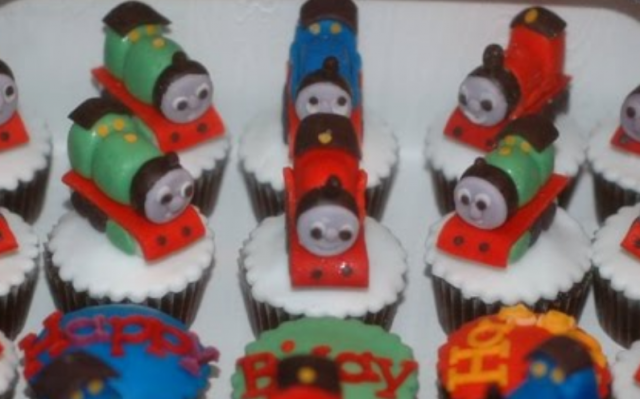 Thomas the train cupcakes with trains cake toppers.PNG