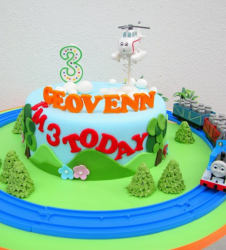 Train track cake with trains and helicopter f rom Thomas the train.PNG