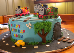 Thomas and friends cake decorations with Thomas, Percy and James on the rails with car cake driving on the road_cute kids birthd