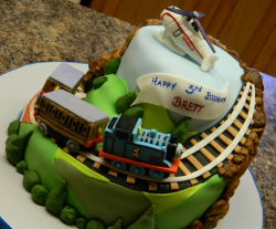 Thomas and friends professional birthday cake with Harold the Thomas the train helicopter.PNG