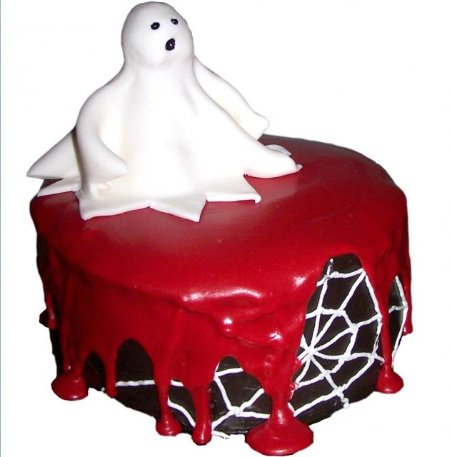 Halloween chocolate cake with blood and ghost topper.JPG