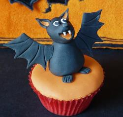 Halloween cupcake with bat toppper.JPG