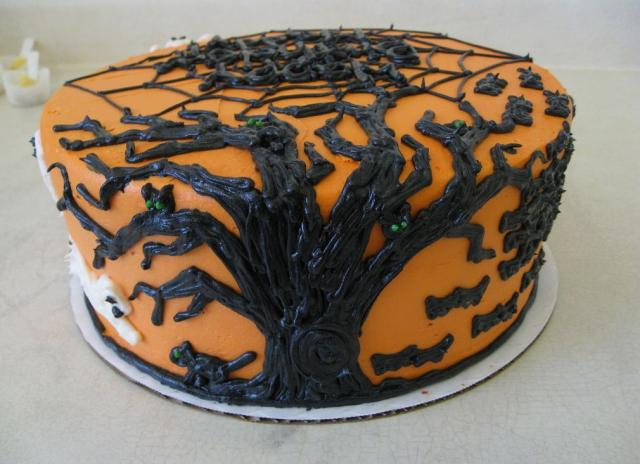 Orange halloween cake with black tree branches.JPG