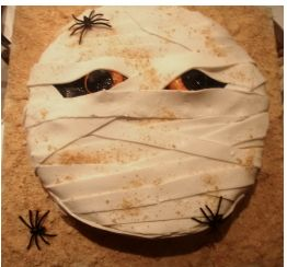 Photo of mummy cake with small spiders.JPG