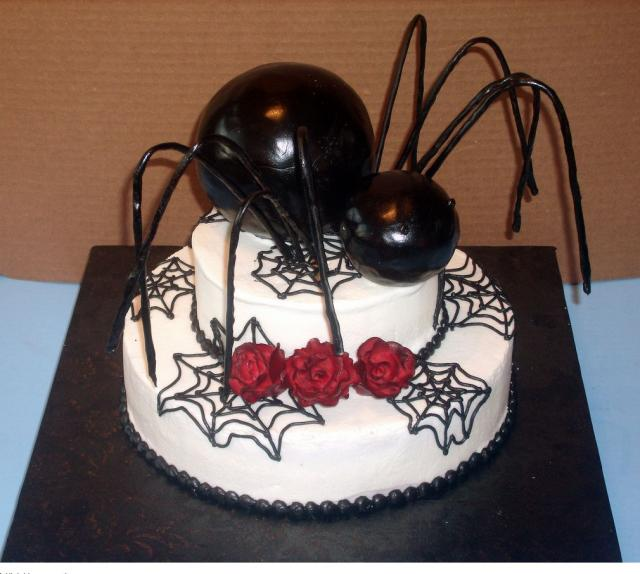 Picture of halloween cake with gaint spider topper.JPG