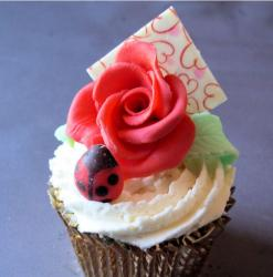 La Creme Cup cake with big rose topper.JPG