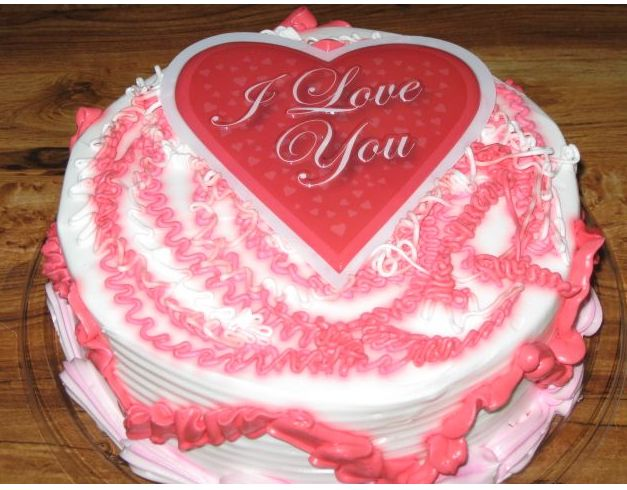 Pink valentines cake with heart in center.JPG