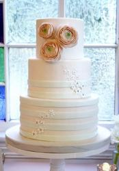 Light Pink 3 tier Wedding Cake with Flowers on Side of Top Tier.JPG