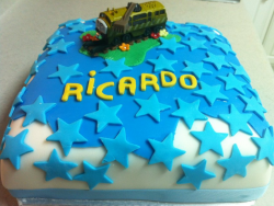 Diesel 10 cake topper on a white sqaure birthday cake with full of blue stars.PNG