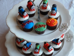 Thomas and friends birthday cupcakes with train cake toppers.PNG