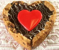 Valentine Giant Chocolate Chip Cookie with bright red heart in the center.JPG