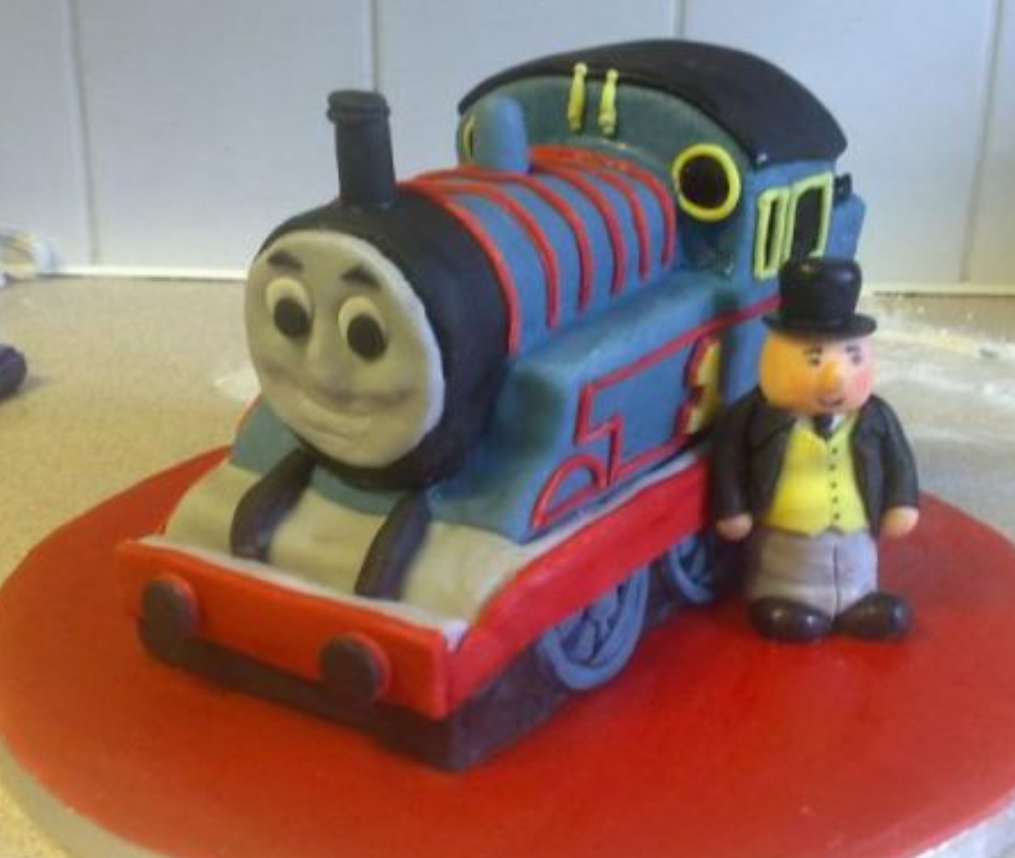 Thomas the train and Sir Topham Hatt cake pictures.PNG