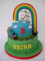 Thomas the train birthday cake with helicopter cake topper with rainbow.PNG