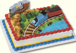 Train theme kids birthday cakes picture of Thomas the train on the train track on Sodor Island.PNG