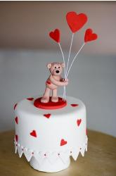 valentines cake ideas of a teddy bear topper holding red heart balloons.JPG