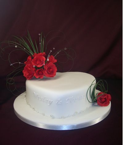 White valentines day cake with red roses.JPG