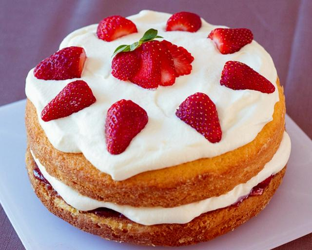 Sponge sandwich cake with white cream fresh strawberries.JPG