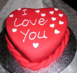 Bright red valentines day cake with white decor.JPG