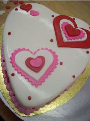 Chic heart shape valentines cake in pink and red patterns.JPG