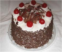 Birthday cake with chocolate with cherries topping.jpg