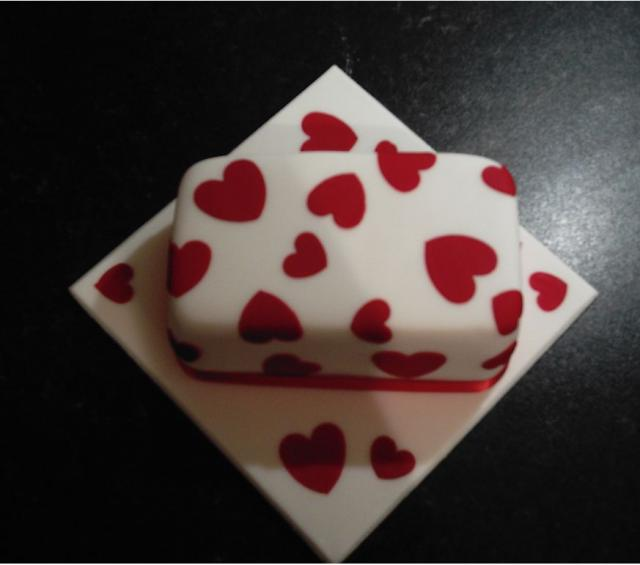 Chic valentines day cake with full of small hearts and white cake.JPG