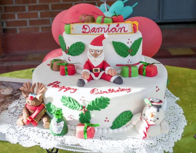 Photo of Christmas Theme Birthday Cake in two Tiers w/ Santa, Reindeer ...