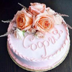 Pink Round Birthday Cake with Fresh Roses on top.JPG
