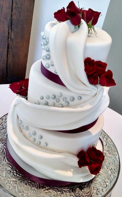 three tier wedding cake with red roses wedding cake with drapes in 3 tiers with fresh roses jpg 20955