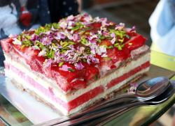 Watermelon Cake with Strawberries and Flower Petals on top.JPG