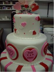 Fancy valentine day cakes in white with red and pink decor.JPG