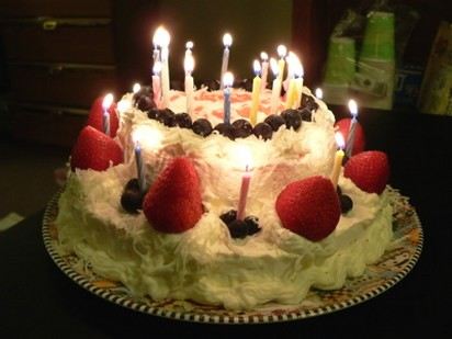 Birday Cake  with big strawberries and candles.jpg