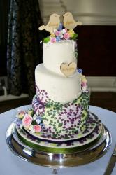 Cool Topsy Turvy Wedding Cake with Lovebirds Toppers & Diamond Tiles.JPG
