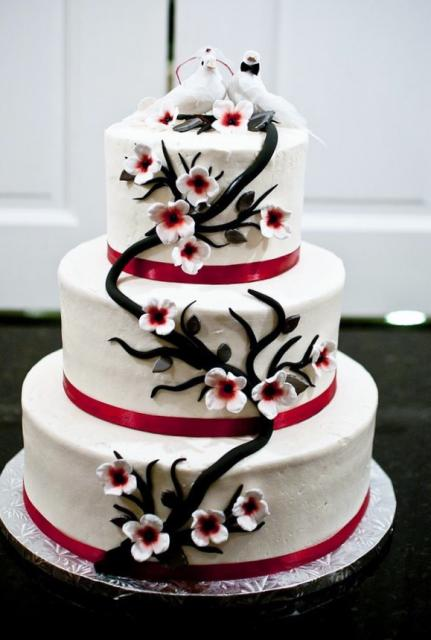 Wedding Cake with Love Birds toppers and cascading tree with White Flowers in 3 Tiers.JPG