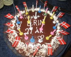 Traditional chocolate Danish birthday cake with full of candels and Danish flags.JPG