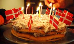 Classic Danish birthday cakes with lighted candels and Danish flags.JPG