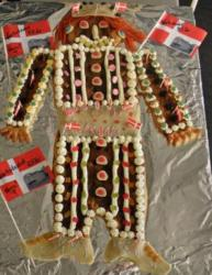 Danish kagemand shaped in Viking decorated with candies and whimped cream and Danish flags.JPG