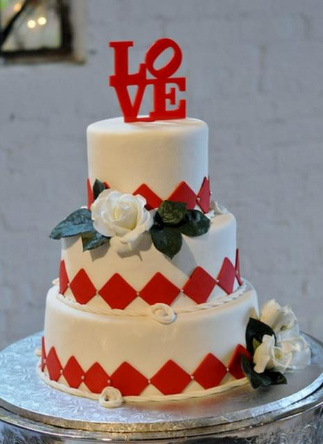 3 Tier Round White Wedding Cake Red Letters Spelling Out LOVE As TopperJPG