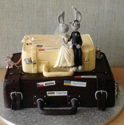 Luggage theme wedding cake with rabbit bride and groom toppers.JPG