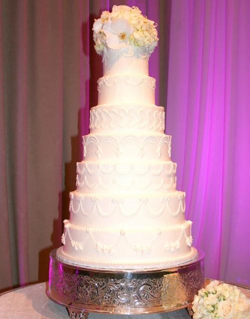 Seven Tier White Wedding Cake With White Rose Flower