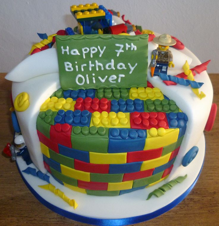Lego birthday cake photos in round shape with lego bricks and lego figure cake topper decor.JPG