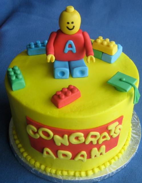 Bright yellow lego cake decorations with large lego cake toppers.JPG