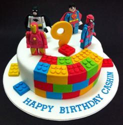 Lego birthday cakes with lego heroes minifigures cake molds.JPG