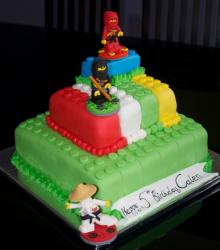 Lego movie cakes with Ninjago theme cake with lego Ninjago figures cake toppers.JPG
