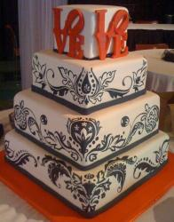Four tier wedding cake with LOVE on top and nice black brush work.JPG