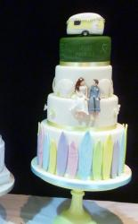 Surf & Travel Theme 4 Tier Wedding Cake with Camper topper & Bride Groom holding hands.JPG
