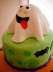 Halloween white ghost on top of green cake with black spider.JPG